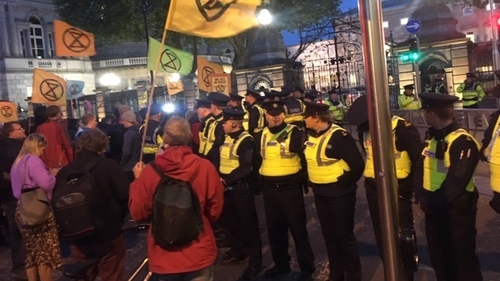 Gardaí created a barrier betweenenvironmental activists and the gates of Leinster House to allow politicians to leave