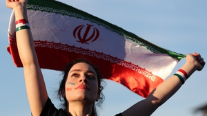 An Iranian woman watches her country play from a fan zone at the 2018 World Cup in Russia