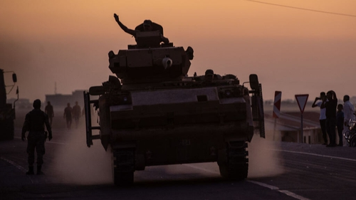 Turkish soldiers prepare to cross the border into Syria