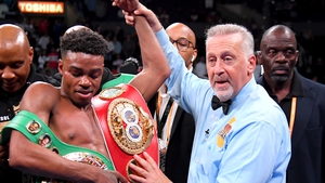 Erroll Spence Jr (L) has his arm raised after he defeated Shawn Porter