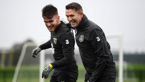 Republic of Ireland assistant coach Robbie Keane with Aaron Connolly