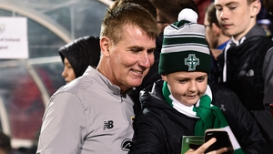 Republic of Ireland U21 head coach Stephen Kenny takes a selfie with a young fan