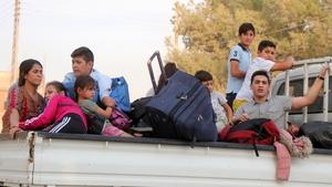 Kurdish families flee their home towns Ras al Ain as Turkish troops advance