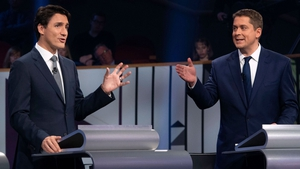 Canadian PM  Justin Trudeau (L) and Conservative leader Andrew Scheer take part in the leaders French language debate