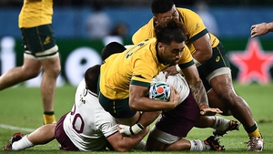 Australia's back row Lukhan Salakaia-Loto (C) is tackled