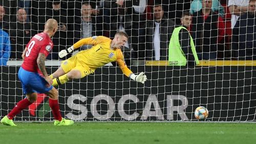 Zdenek Ondrasek slots a famous winner past Jordan Pickford in the England goal