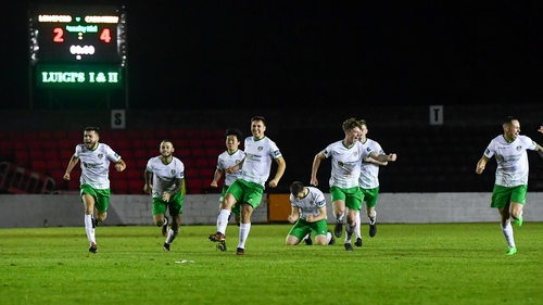 Cabinteely players celebrate the win