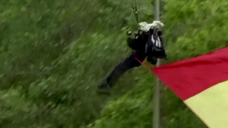 Parachutist hits pole at Spanish national day parade