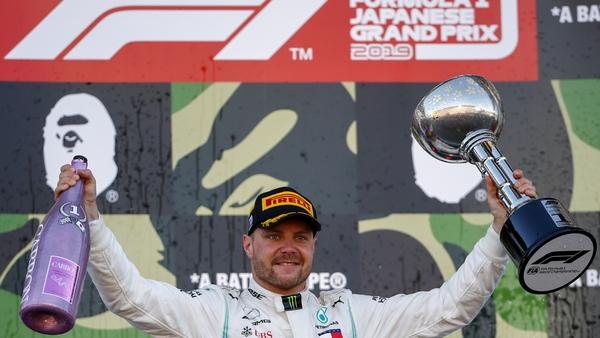 Bottas celebrates on the podium