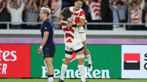 Japan's Kenki Fukuoka celebrates scoring his sides third try