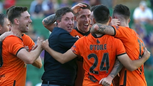 Robbie Fowler joins in the celebrations after Roy O'Donovan's late leveller