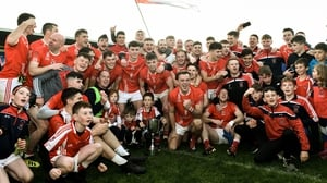 Padraig Pearses players and supporters celebrate with the Fahey Cup