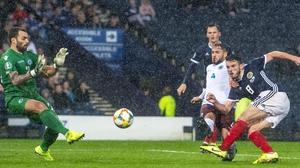 Scotland's John McGinn completes his hat-trick