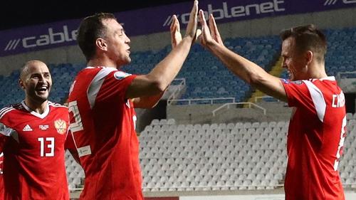 Russia's Fyodor Kudryashov, Artyom Dzyuba and Denis Cheryshev (L-R) celebrate in Cyprus