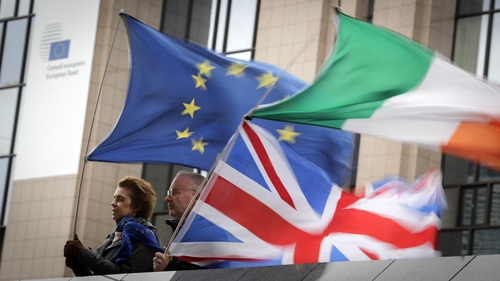 Anti-Brexit demonstrators wave a European, an Irish and a British flag in Brussels last week