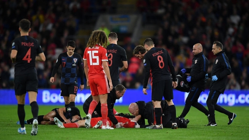 Daniel James receives medical attention after an aerial clash with Croatian defender Domagoj Vida