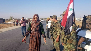 Images from the Syrian Arab News Agency shows civilians welcoming Syrian army soldiers in Tal Tamr