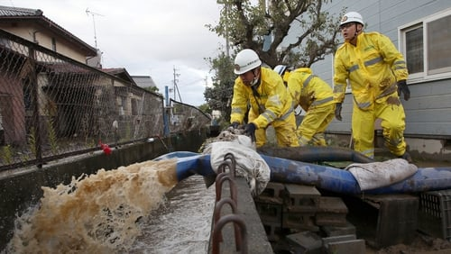Pumping operations were being carried out where floodwaters submerged homes and vehicles after Typhoon Hagibis