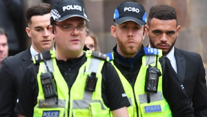 Police escort Derby County footballers Tom Lawrence (rear left) and Mason Bennett (rear right) from Derby Magistrates' Court