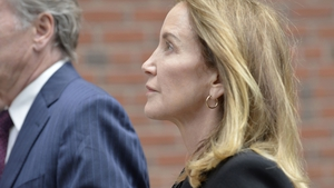 Felicity Huffman (pictured in May) - Entered a guilty plea in May to conspiracy related to her payment of $15,000 to have someone secretly correct her daughter's answers on the SAT standardised test used for college admissions