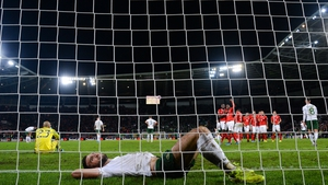 Shane Duffy and Darren Randolph - two of Ireland's better players in Geneva - cut dejected figures as the hosts make it 2-0 in the dying seconds