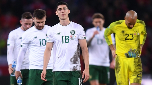 Dejected Ireland players leave the field after their defeat to Switzerland