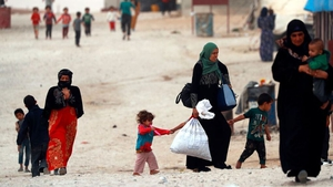 Displaced Syrians who were forced to leave their homes by the war against IS are pictured walking around at the Ain Issa camp