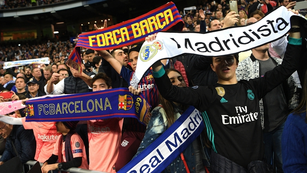 Fans from both clubs show their colours at El Clasico at Estadio Santiago Bernabeu last March