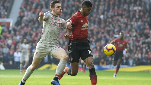 Andy Robertson (L) in action against Manchester United's Marcus Rashford earlier this year
