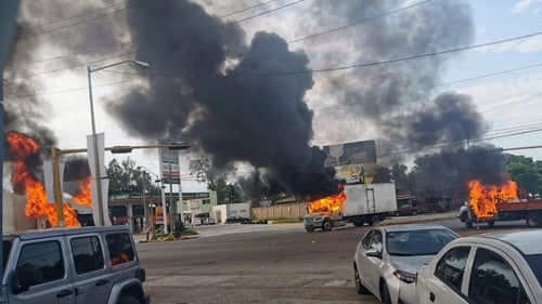 Simultaneously, fighters swarmed through the city of Culiacan, battling police and soldiers in broad daylight