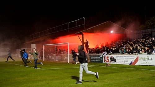 Bohemians fans pour onto the pitch at full-time