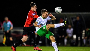 Villius Labutis of Cabinteely in action against Jake Hyland