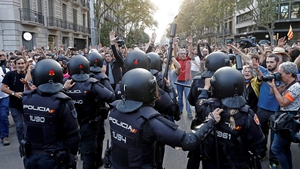 Local police on guard as people gathered at Urquinaona square in Barcelona