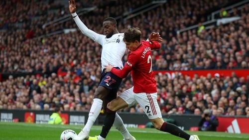 Victor Lindelof of Manchester United challenges Liverpool's Divock Origi at Old Trafford