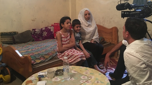 Elham with two of her children who live in the Shatila refugee camp on the outskirts of Beirut