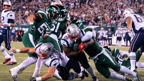 New England Patriots' Sony Michel runs the ball in for a touchdown against the Jets