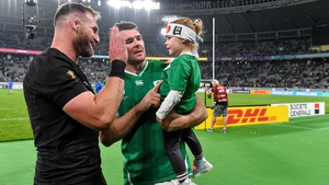 Kieran Read enjoys a chat with Peter O'Mahony and his daughter Indie following the quarter-final win last weekend