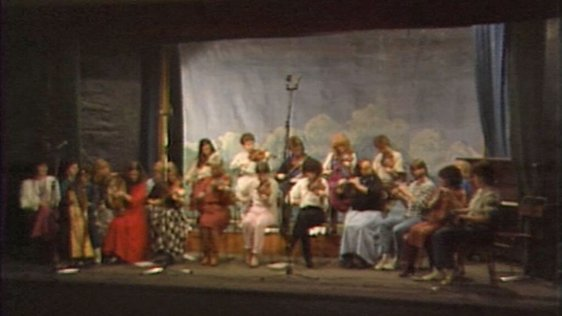 Twenty members of Macalla perform at Oireachtas '84, Gaoth Dobhair (1984)