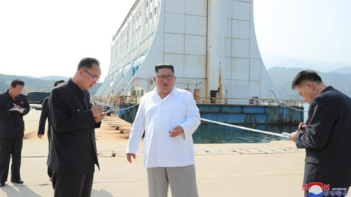 The North Korean leader was quoted as saying: 'They were built like makeshift tents in a disaster-stricken area or isolation wards' (Courtesy: KNCA)