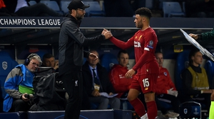 Jurgen Klopp shakes hands with Alex Oxlade-Chamberlain as he is substituted against Genk