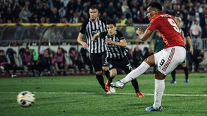 Anthony Martial slots away a penalty in the 43rd minute