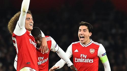Nicolas Pepe (C) celebrates scoring his team's third goal with Matteo Guendouzi (L) and Hector Bellerin