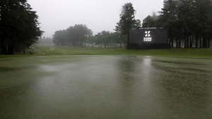 Heavy rain at the 18th green of the Zozo Championship