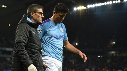 Rodri (R) leaves the pitch injured during win over Atalanta