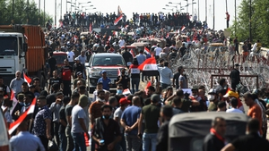 Protesters gather on the Al-Jumhuriyah Bridge during an anti-government protest
