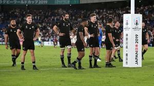 New Zealand players look dejected in defeat