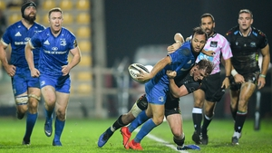Leinster's Jamison Gibson-Park offloads after coming under pressure from Zebre's Joshua Renton