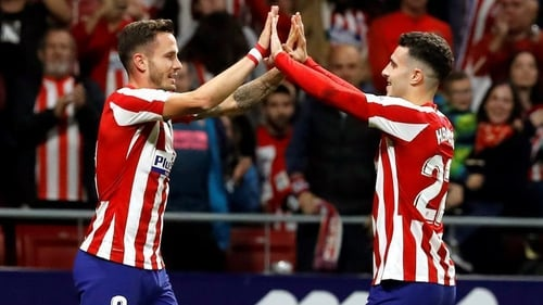 Saul Niguez (L) celebrates with team-mate Mario Hermoso after Atletico's first