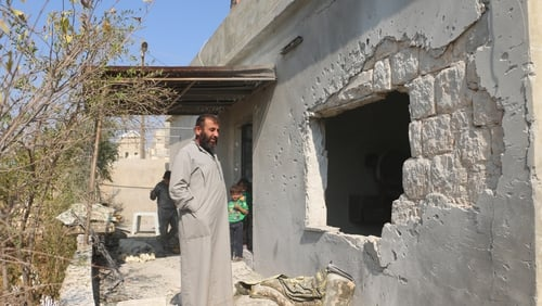 Villagers survey the scene in Barisha after the deadly US raid
