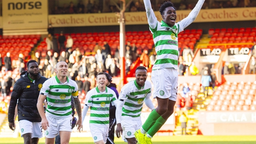 Jeremie Frimpong celebrates with the Celtic fans following the game